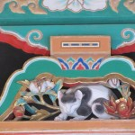 The most famous carving on the Toshogu Shrine buildings, The Sleeping Cat. It sits on the lintel above the entrance to Ieyasu Tokugawa's resting place. There is a sculpture of a sparrow on the backside of the Sleeping Cat. The sparrow will be eaten if the cat is awake. However, the sparrow and the cat co-exist. It means that nation wide chaos is over and peaceful society has come.