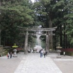 Large stone torii gates mark the entry to Toshogu shrine.